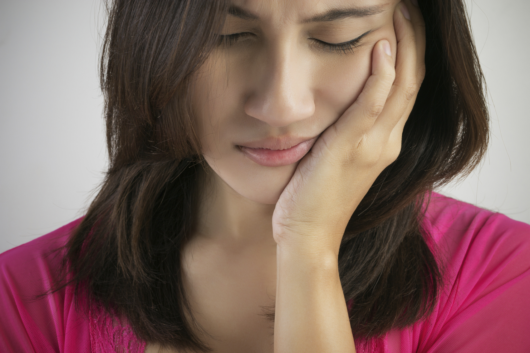 Woman feels a toothache