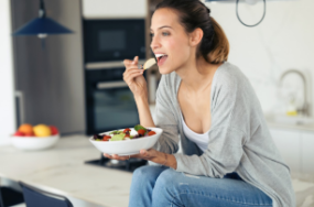 women eating a healthy meal at home with nice teeth