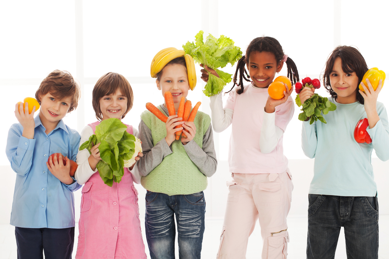 kids holding healthy fruits and vegetables